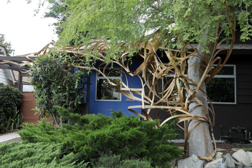 """Rebecca Niederlander's sculpture in Eagle Rock, """"Central Sensitization,"""" is made from wood slats bolted together."""