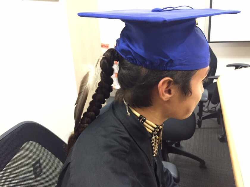 A photo of the feather Christian Titman, 18, is allowed to wear at Clovis High School's graduation on June 4.