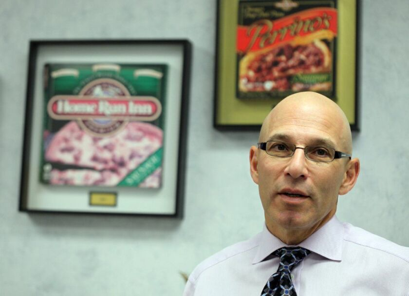 Joe Perrino, then CEO of Home Run Inn, is seen in 2010. He died in July at age 64, relatives said.