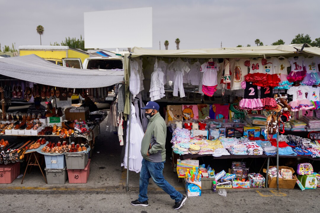 Visitors walk past vendors at the Paramount Swap Meet.