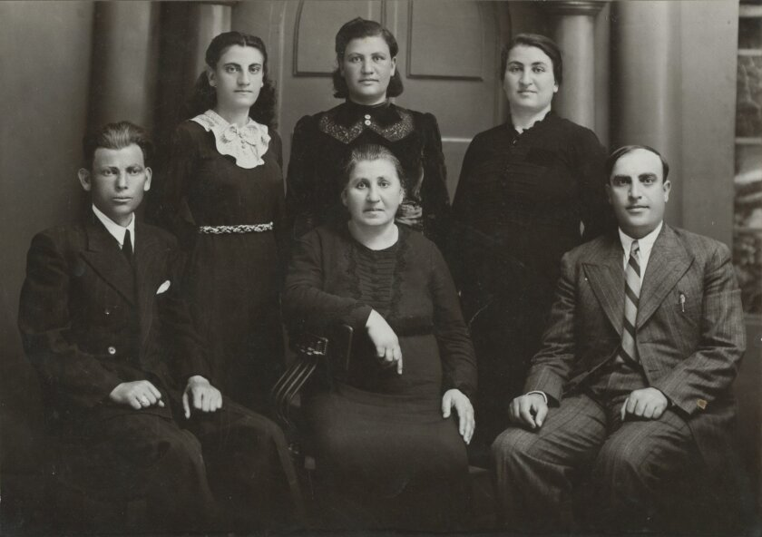 Arshaluys Yousuf with five of her children. Arshaluys is seated in the center with son Sargon to her