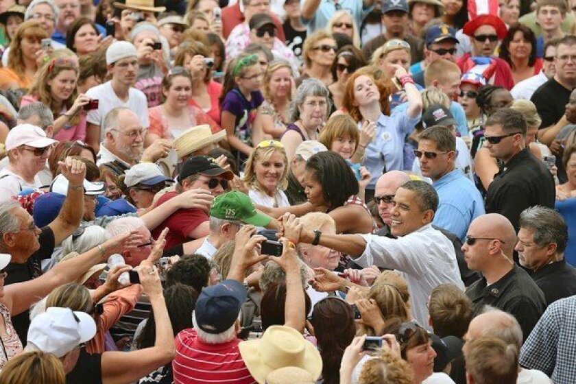 President Obama and First Lady Michelle Obama greet the crowd at a campaign rally in Dubuque, Iowa.