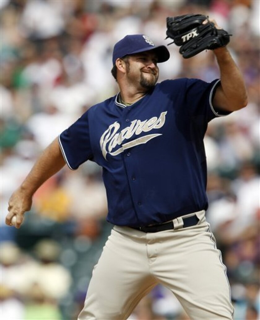 A day after blowing his first save of the season, closer Heath Bell worked a 1-2-3 ninth Sunday in a 5-2 Padres victory over the Colorado Rockies. (AP Photo/David Zalubowski)