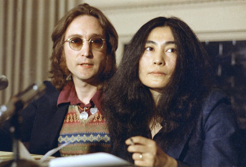 """FILE - In this April 2, 1973 file photo, John Lennon and his wife, Yoko Ono, speak at a news conference in New York. Six months before he died, Lennon set sail from Newport, R.I., on an ocean adventure to Bermuda that awakened his desire to make music again and is now being chronicled in an electronic format he could not have conceived of. A new app, """"John Lennon: The Bermuda Tapes,"""" is being offered for sale on Apple devices. It's loaded with interactive features, music, photos and interviews that detail a relatively unexamined slice of the former Beatle's life. An exhibit of Lennon's lithographs will be shown this weekend in Del Mar. (AP Photo, File)"""