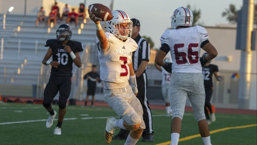 Ocean View's Noah Hickman quarterback scores a touchdown in the first half against Los Amigos during
