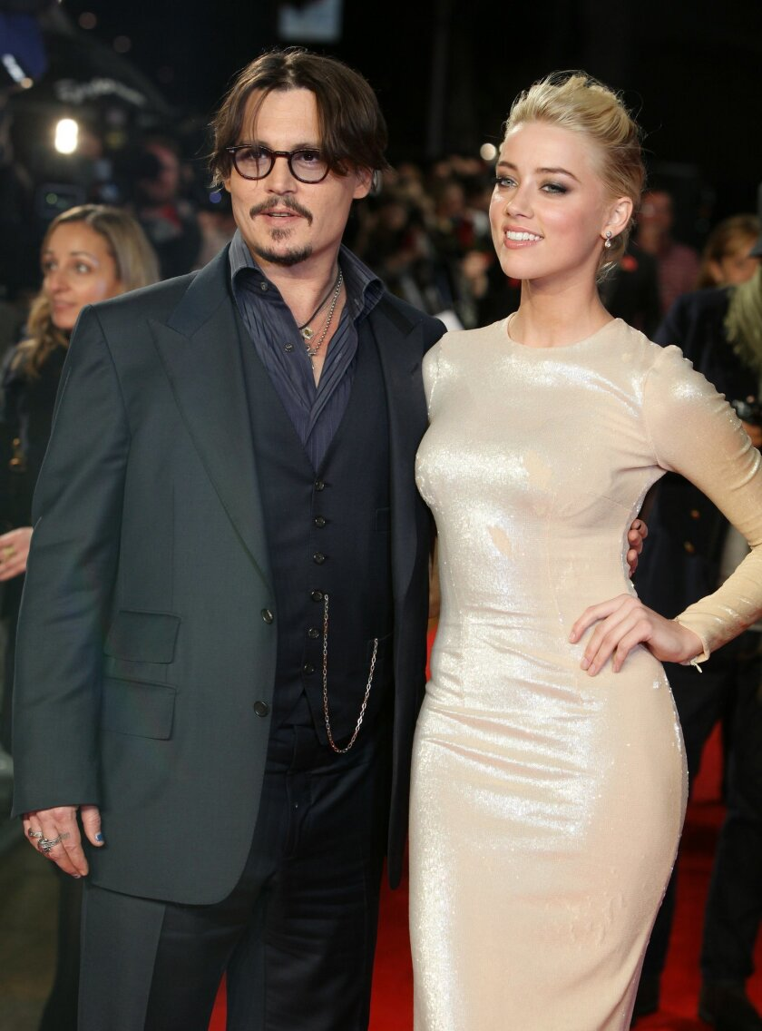 """FILE - In this Nov. 3, 2011 file photo, U.S. actors Johnny Depp, left, and Amber Heard arrive for the European premiere of their film, """"The Rum Diary,"""" in London. Court records show Heard filed for divorce in Los Angeles Superior Court on Monday, May 23, 2016, citing irreconcilable differences. The"""