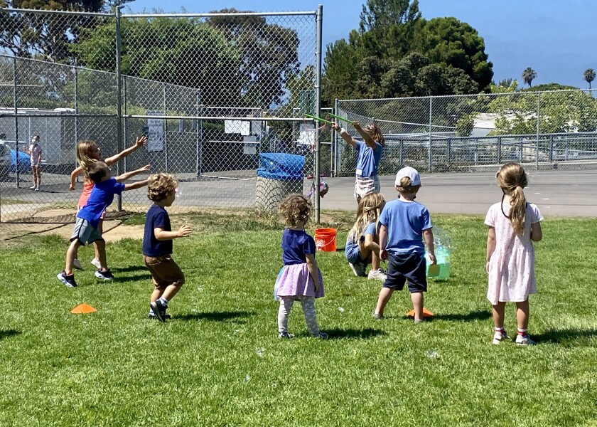 """A """"Bird Squad"""" ambassador leads a group of incoming Bird Rock Elementary School kindergarten students in bubble play."""