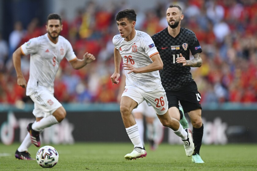 Spain's Pedri runs with the ball during the Euro 2020 soccer championship round of 16 match between Croatia and Spain at the Parken Stadium in Copenhagen, Monday June 28, 2021. (Stuart Franklin, Pool Photo via AP)