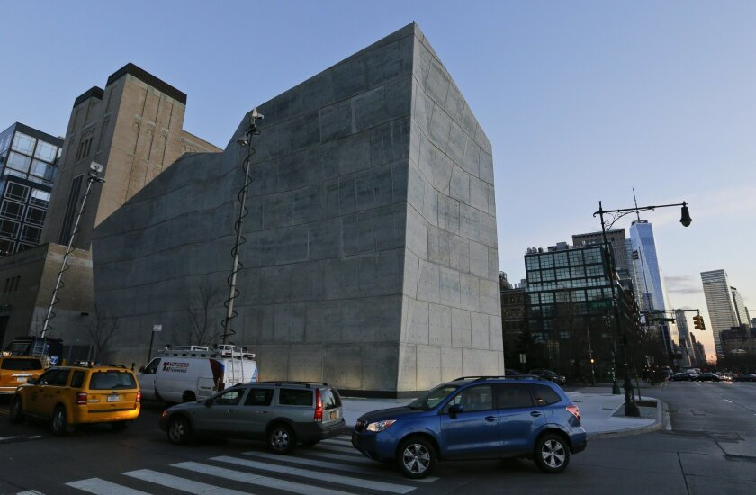 In this Thursday, Jan. 21, 2016, photo, cars pass the Spring Street Salt Shed in New York. The building looks like a modern art painting come to life, all angles and edges, with concrete walls that can look bluish or grayish or whitish, or some combination of the three.  (AP Photo/Frank Franklin II