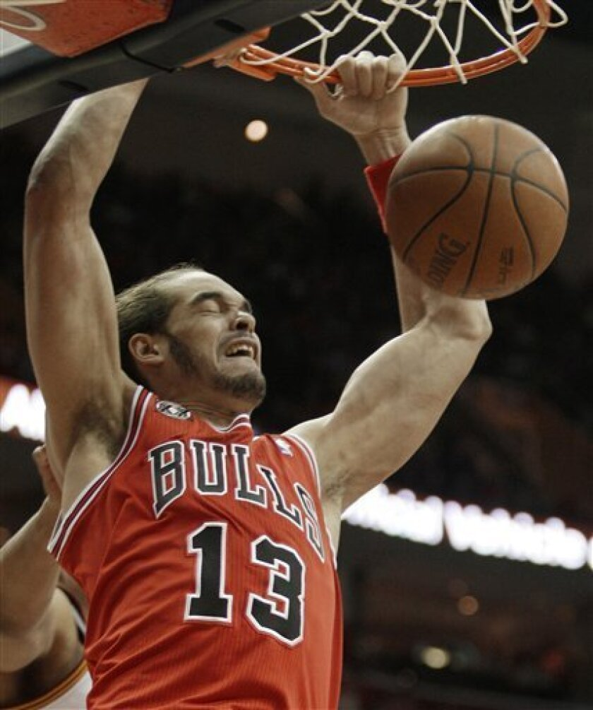 Chicago Bulls' Joakim Noah dunks the ball against the Cleveland Cavaliers in the first quarter in an NBA basketball game Friday, April 8, 2011, in Cleveland. (AP Photo/Tony Dejak)