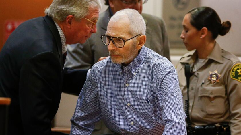 Robert Durst, center, pictured at an earlier hearing speaking with his attorney, Dick DeGuerin, appeared in court Sept. 20 for a hearing in his murder case.