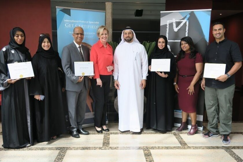 "Marie Betts-Johnson (fourth from left) with Dr. Ahmad Tahlak and participants in the ""Train to Be an International Protocol Specialist"" certification program in Dubai.