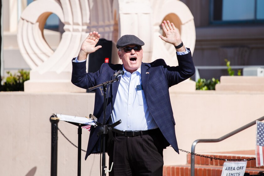 Pastor Art Hodges of the South Bay United Pentecostal Church speaks during a Nov. 1 rally
