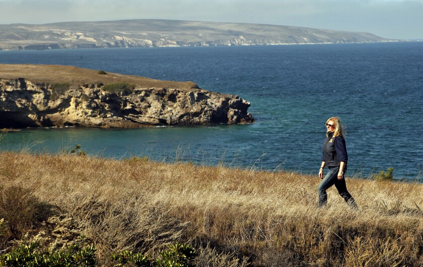 In this 2011 photo, Nita Vail walks along a bluff on Santa Rosa Island, part of the Channel Islands