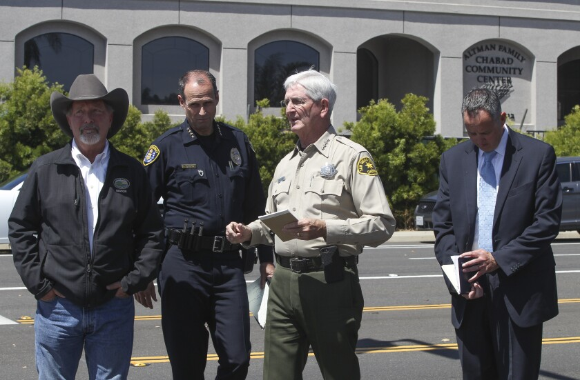 At Chabad of Poway, from left, Poway Mayor Steve Vaus, San Diego Police Chief David Nisleit, San Diego Sheriff Bill Gore and FBI Assistant Special Agent Omer Meisel.