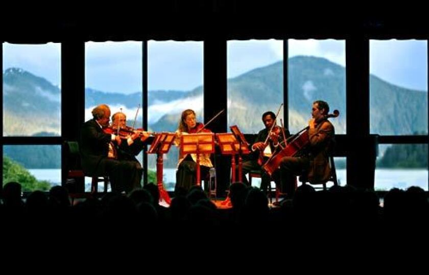 Mountains provide a dramatic backdrop to a Sitka Summer Music Festival evening concert at Harrigan Centennial Hall.