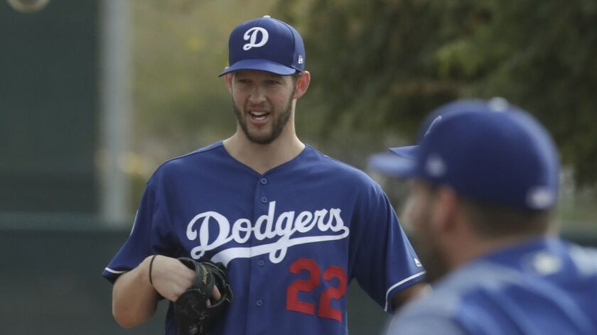 Los Angeles Dodgers' Clayton Kershaw waits during a spring training baseball workout Wednesday, Feb.