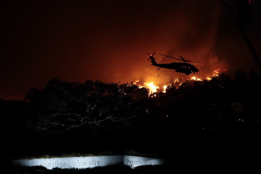 Woolsey fire destroys scores of homes, forcing 200,000 to