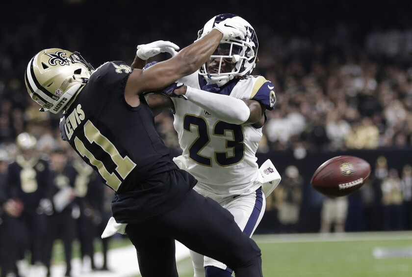 Rams cornerback Nickell Robey-Coleman makes contact with New Orleans Saints wide receiver TommyLee Lewis on a key pass during last year's NFC championship game.