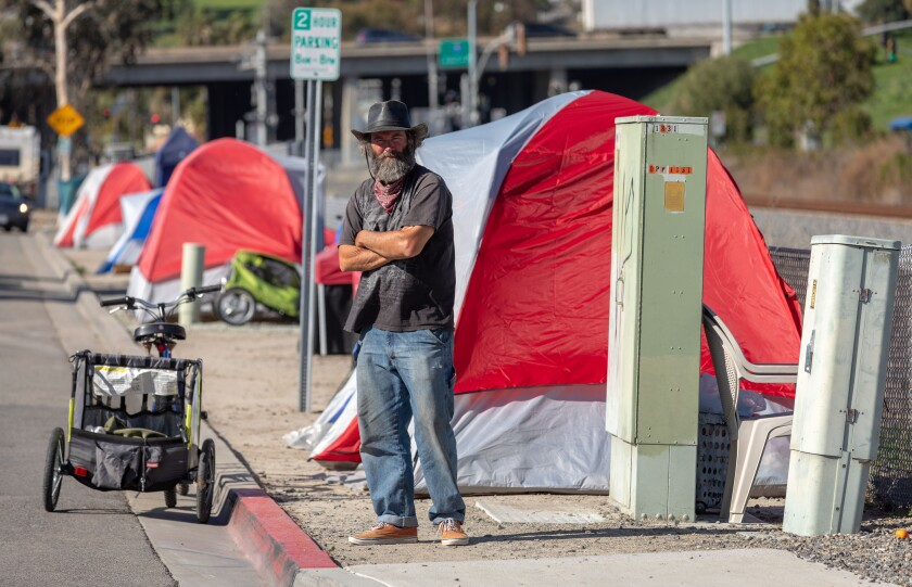 Rodney McGough, 52, who is homeless, is one of more than a dozen people living in tents on Oceanside Boulevard in Oceanside.