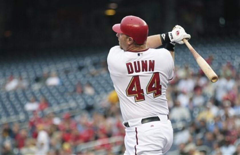 Washington Nationals' Adam Dunn watches the ball as he hits a home run during the first inning of a baseball game against the Pittsburgh Pirates, Wednesday, June 9, 2010, in Washington. (AP Photo/Manuel Balce Ceneta)
