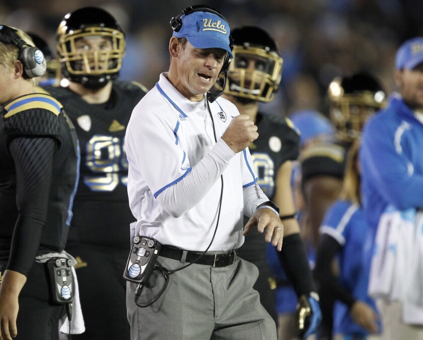 UCLA Coach Jim Mora reacts after a fumble recovery by the Bruins during a win over Washington in November. Mora and the Bruins want to put last year's bowl loss to Baylor behind them with a win over Virginia Tech in the Sun Bowl.