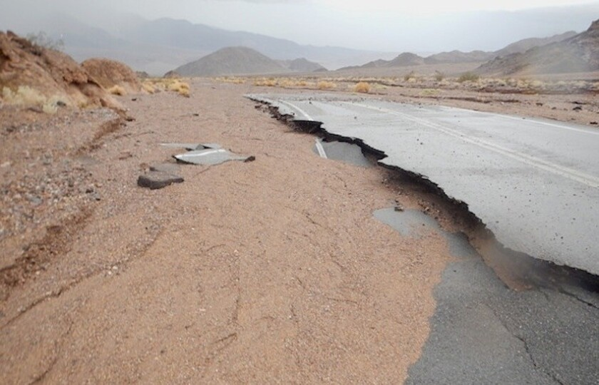 Road damage and mudslide from rain Sunday at Death Valley National Park.