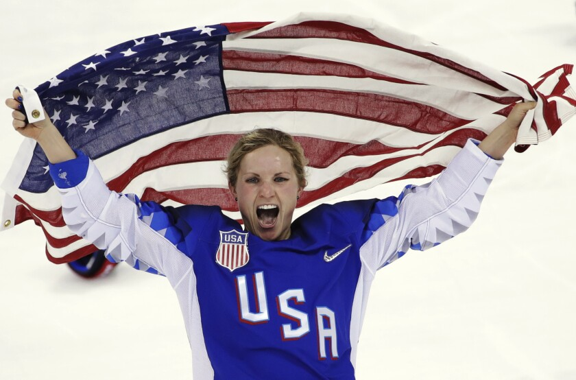 Jocelyne Lamoureux-Davidson celebrates after Team USA's victory over Canada in the gold medal game at the 2018 Winter Olympics.