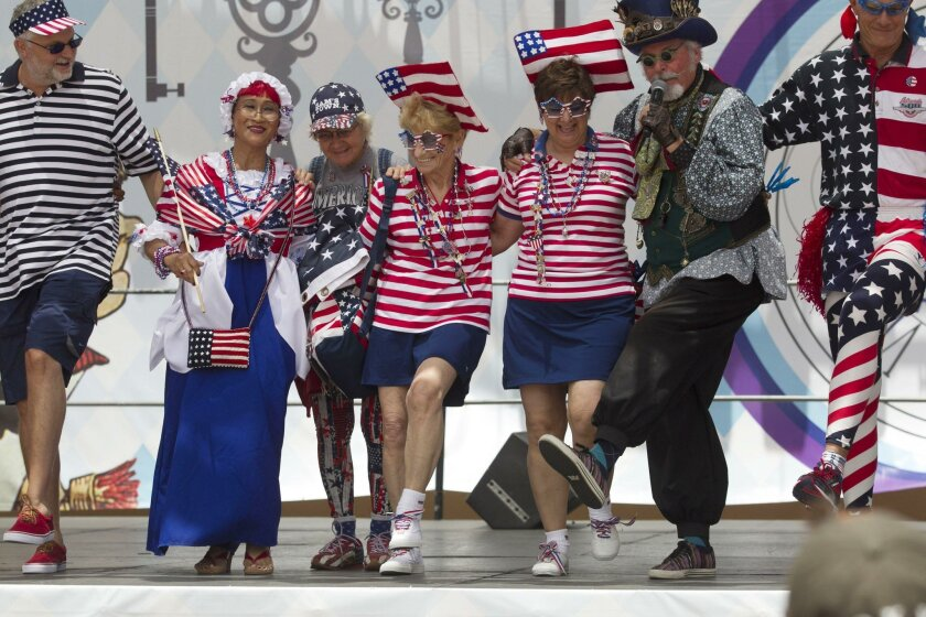 Jerry Hager (right) leads Most Patriotic Fashion Show participants in a chorus line kick Monday at the San Diego County Fair as it wrapped up another year.