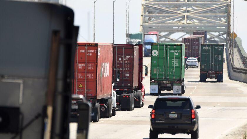 Trucks approach the Gerald Desmond Bridge at the Los Angeles-Long Beach port complex.