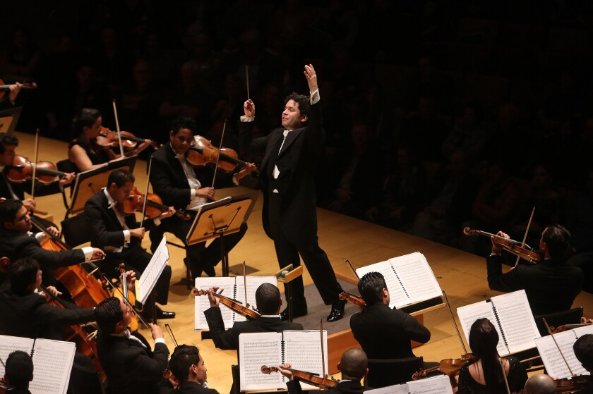 Gustavo Dudamel conducts the Simón Bolívar Symphony Orchestra of Venezuela as they play Tchaikovsky's Symphony No. 2 during the Los Angeles Philharmonic's TchaikovskyFest at the Walt Disney Concert Hall in 2014.