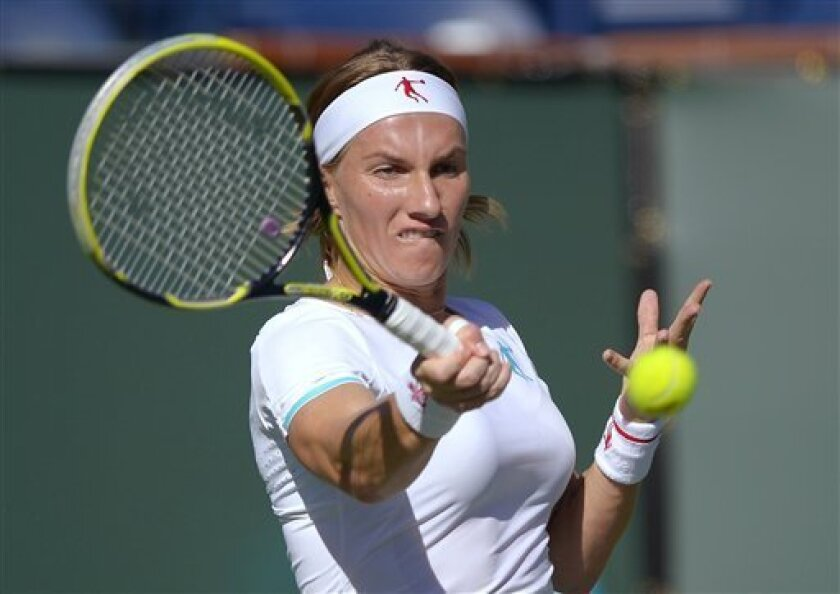 Svetlana Kuznetsova, of Russia, returns a shot to Andrea Hlavackova, of the Czech Republic, at the BNP Paribas Open tennis tournament, Wednesday, March 6, 2013, in Indian Wells, Calif. (AP Photo/Mark J. Terrill)