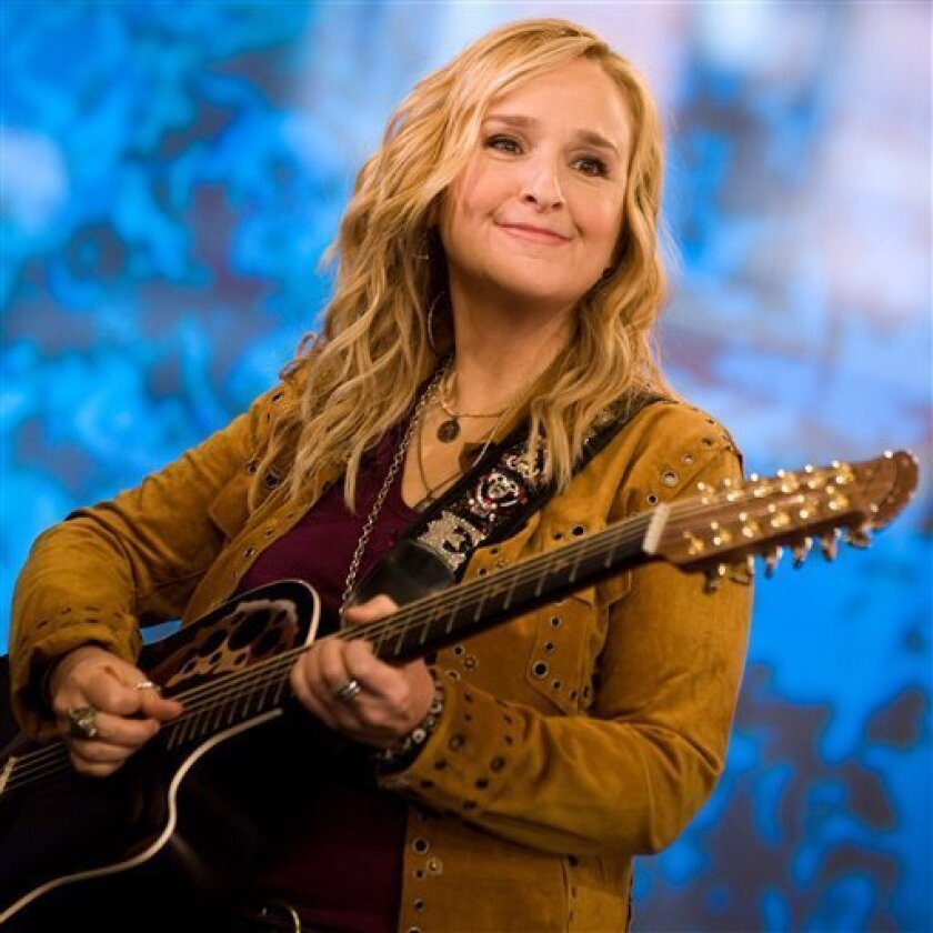"""FILE - In this April 30, 2010 file photo, Melissa Etheridge performs on ABC's """"Good Morning America"""" show in New York. (AP Photo/Charles Sykes, file)"""