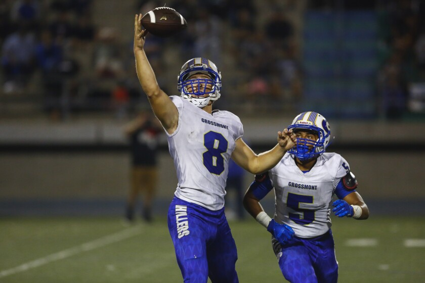 Grossmont's Robert Tucker watches the ball as quarterback Jaime Odom reaches for the snap. Tucker had 462 all-purpose yards in the Foothillers' win last week.