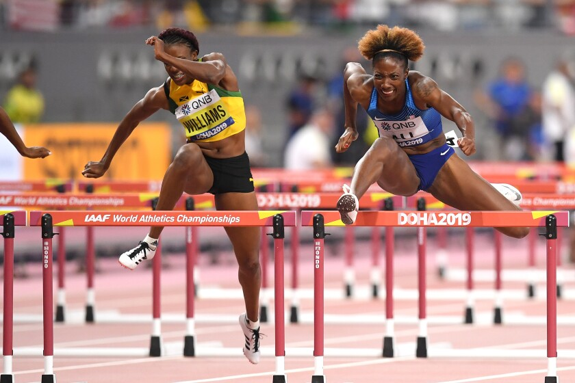 Nia Ali, right, competes in the women's 100-meter hurdles at the IAAF World Athletics Championships on Sunday.