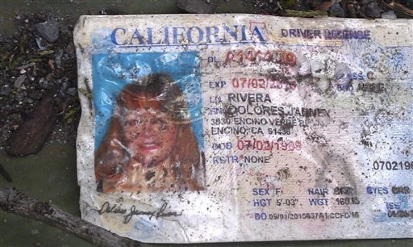 A California driver's license bearing the name of Jenni Rivera sits on the ground at the site where a plane allegedly carrying Rivera crashed near Iturbide, Mexico Sunday Dec. 9, 2012. The wreckage of a the small plane believed to be carrying Jenni Rivera, the U.S-born singer whose soulful voice and unfettered discussion of a series of personal travails made her a Mexican-American superstar, was found in northern Mexico on Sunday. Authorities said there were no survivors. (AP Photo)