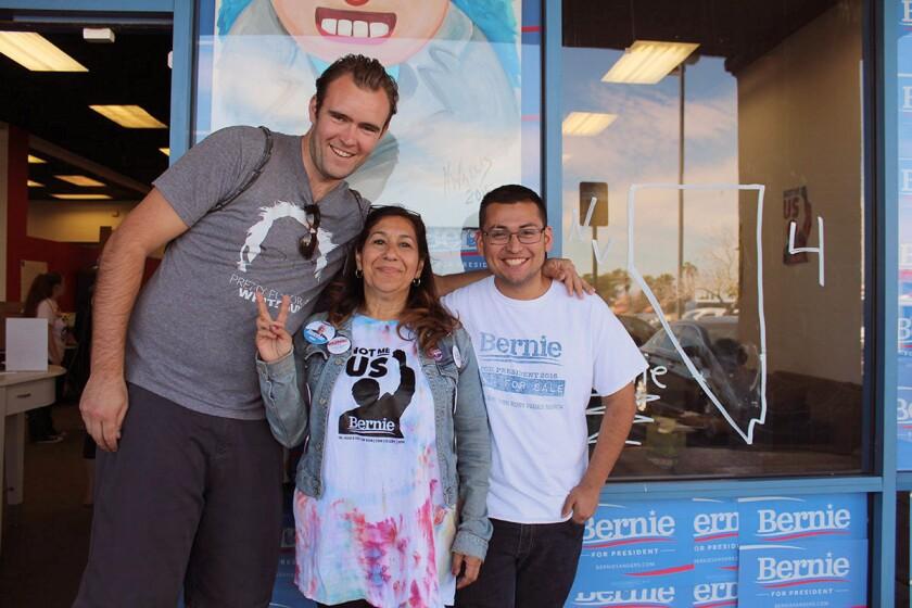 Yolanda Gonzalez, center, poses with fellow Californians and Bernie Sanders supporters James Albert, left, and Ronaldo Lizárraga-Angulo, right.
