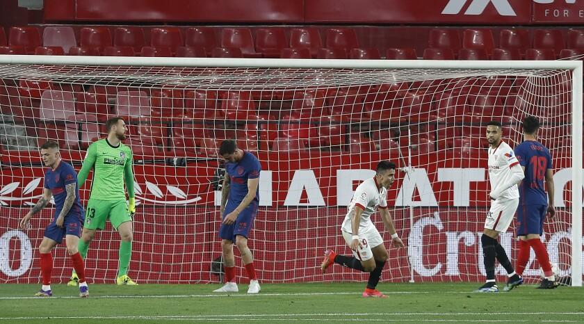 Sevilla's Marcos Acuna, celebrates after scoring during a Spanish La Liga soccer match between Sevilla and Atletico de Madrid at the Ramon Sanchez-Pizjuan stadium in Seville, Spain, Sunday, April 4, 2021. (AP Photo/Angel Fernandez)