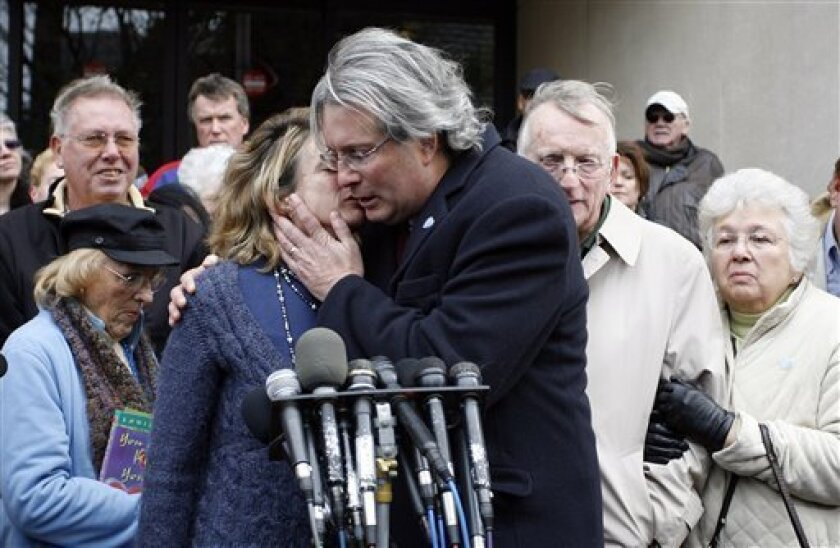 Hanna Chapman, left, hugs her brother Dr. William Petit Jr., right, as they speak with the media following the sentence given to Steven Hayes, not pictured, following jury deliberations Monday, Nov. 8, 2010, at the New Haven, Conn., County Courthouse. Petit is the sole survivor of the 2007 Cheshire, Conn., home invasion where his wife, Jennifer Hawke-Petit and their daughters, Hayley and Michaela, were murdered. Steven Hayes has been convicted in the triple murder. (AP Photo/Stew Milne)
