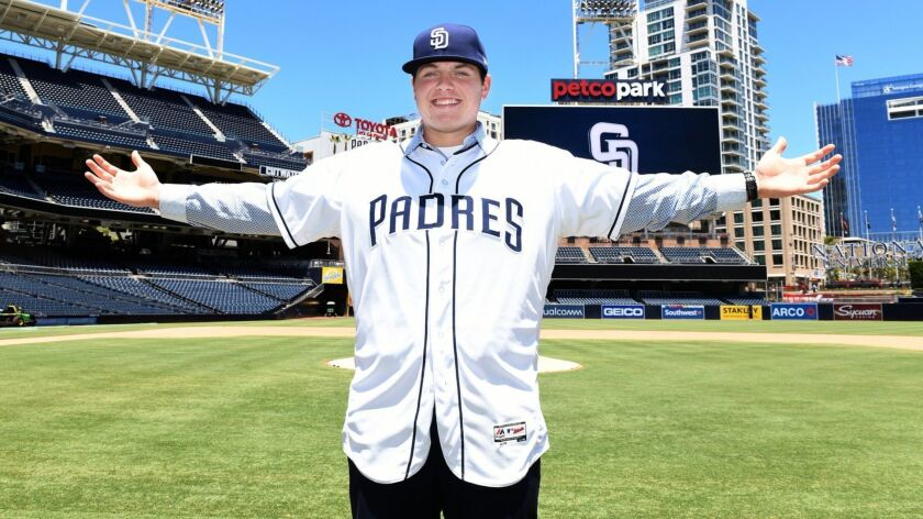 Ryan Weathers, the 2018 number one draft pick, of the San Diego Padres is introduced to media and poses for photos at Petco Park on July 2, 2018 in San Diego, California.