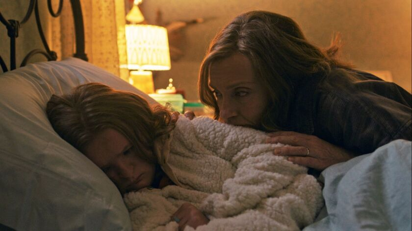 """This image released by A24 shows Milly Shapiro, left, and Toni Collette in a scene from """"Hereditary."""