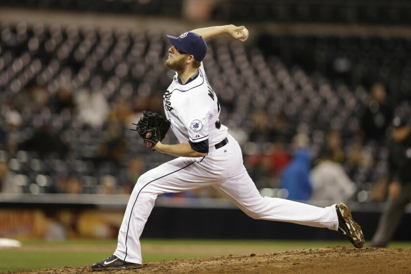 San Diego Padres pitcher Brandon Maurer pitches to a Washington Nationals batter during the ninth inning in a baseball game Friday, May 15, 2015, in San Diego. (AP Photo/Gregory Bull)