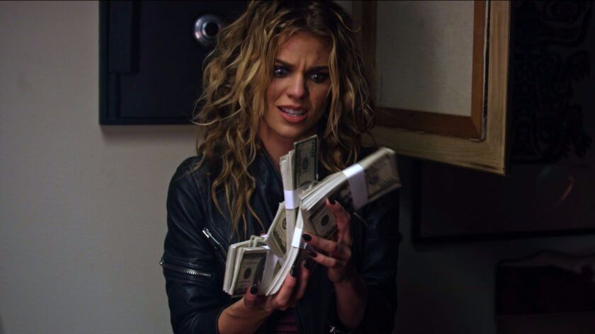"AnnaLynne McCord as Liza in the film ""68 Kill."""