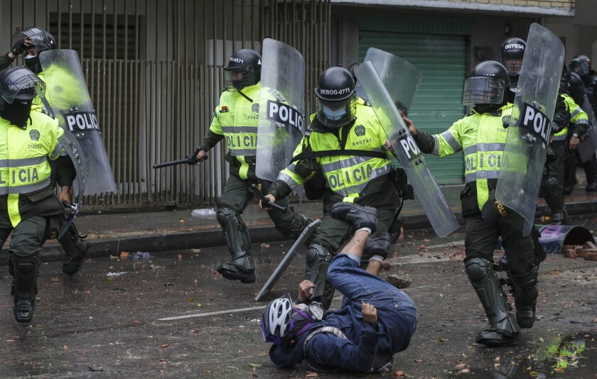 Anti-government protester clashes with police in Bogota, Colombia, Wednesday, June 9, 2021. The protests have been triggered by proposed tax increases on public services, fuel, wages and pensions. (AP Photo/Ivan Valencia)