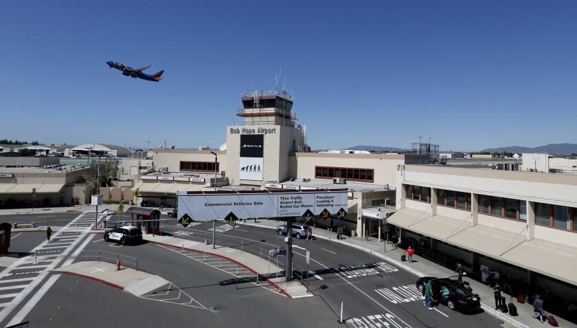 A Southwest airplane takes off over the tower at Bob Hope Airport in Burbank on March 24.
