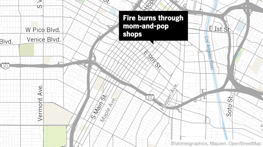 Blaze rips through row of garment shops housed in old