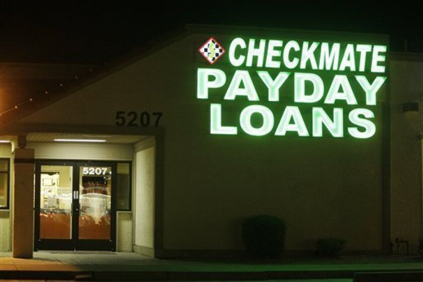 Neon signs illuminate a payday loan business in Phoenix on Tuesday, April 6, 2010, one of 650 operating in the state with some open 24-hours a day. A growing backlash against payday lending practices have prompted legislatures around the country to crack down on the businesses. (AP Photo/Ross D. Fr