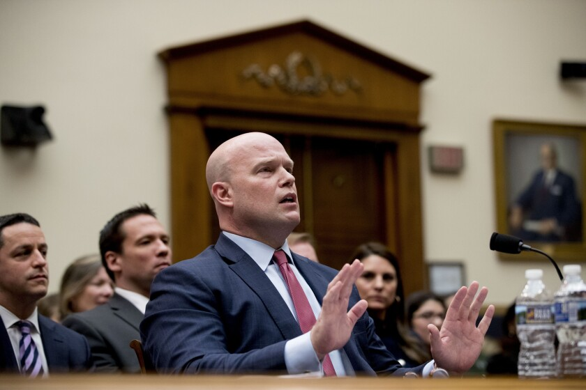 Acting Attorney General Matthew Whitaker speaks after telling Judiciary Committee Chairman Jerrold Nadler, D-N.Y., that his time had expired during questioning on Capitol Hill on Feb. 8, 2019.