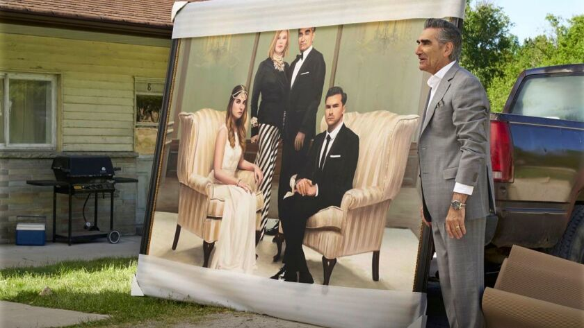 """A group portrait from better days comes back to haunt Johnny Rose (Eugene Levy) and family in the fourth season of Pop's """"Schitt's Creek."""""""