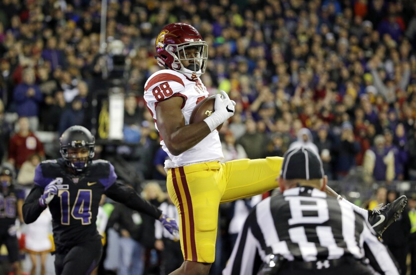 USC tight end Daniel Imatorbhebhe (88) comes down in the end zone as he catches a touchdown pass in the second half against Washington on Nov. 12, 2016.